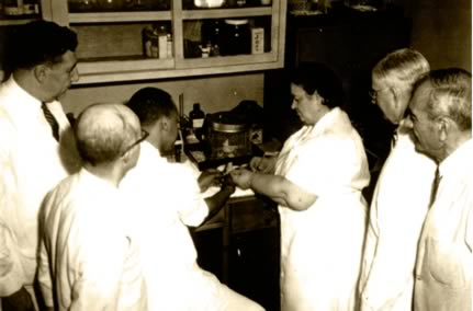 Rene Caisse and Dr Brusch in Lab with other Doctors